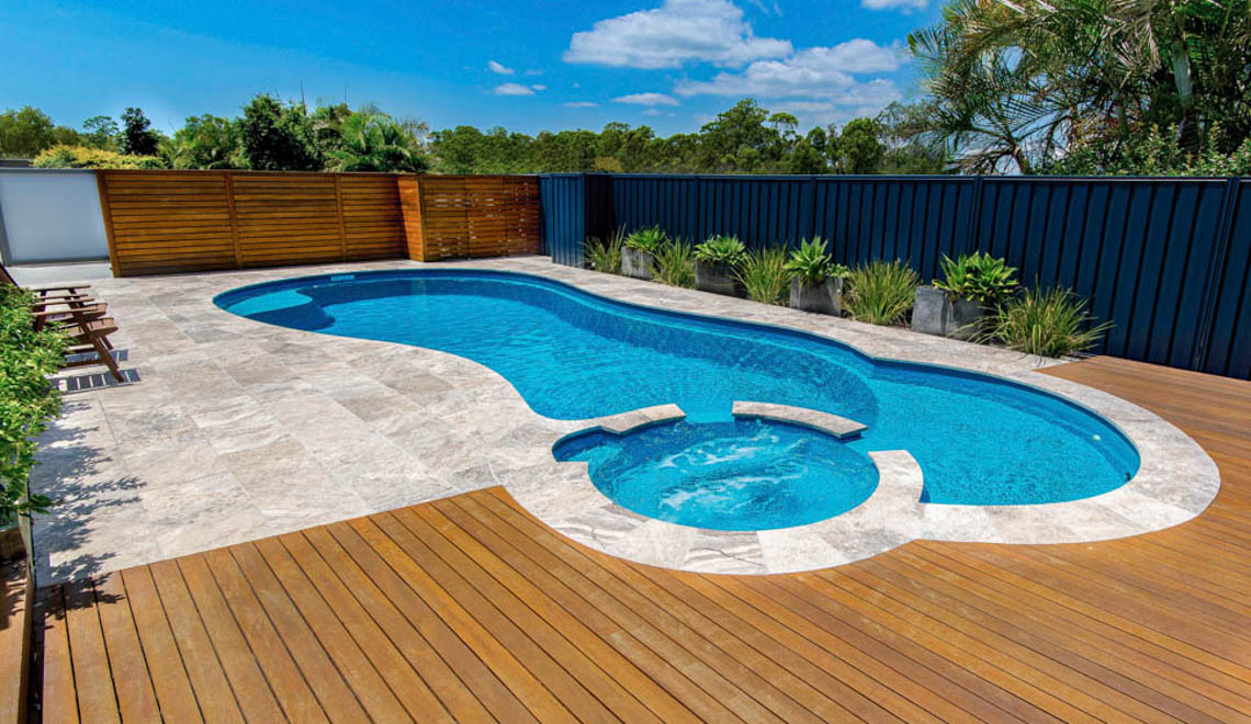 Leisure Pools Allure in-ground composite swimming pool with built-in spa and splash deck