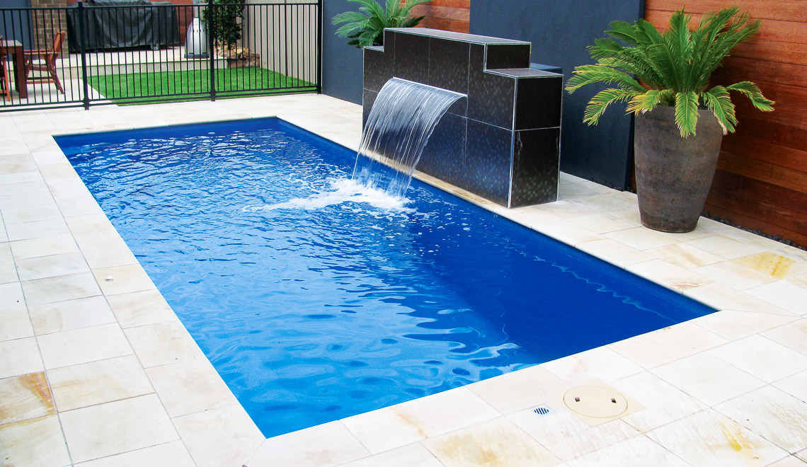 Leisure Pools Palladium Plunge rectangular composite swimming pool with built-in steps